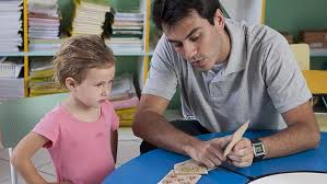 male tutor with a sml child
